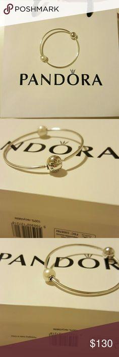 *SOLD* Pandora Essence Bangle New. Never worn. Has pearl dignity charm. Size small. Pandora Jewelry Bracelets