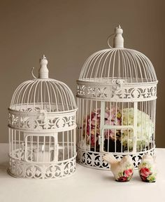Birdcages are fantastic wedding reception centrepieces!   Birdcages will look stunning filled with your favorite flowers or with a simple candle inside – or both!!  lo  Decorate them with white pearls draped over the top to give that elegant touch or place them on one of our mirror tiles with votive or tea lights candles surrounding them. Truly magical!!
