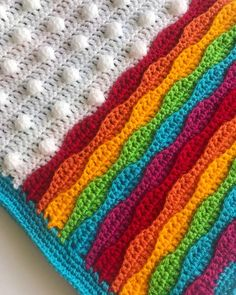 The Cloudy with a Chance of Rainbows crochet blanket pattern is suitable for an Intermediate Crocheter and the pattern is written in UK corchet terms. The pattern is fully customisable as instructions are given explaining how to adapt the size of your blanket. This pattern does not include step by Zig Zag Crochet Pattern, Easy Beginner Crochet Patterns, Afghan Crochet Patterns, Crochet Stitches, Crochet Afghans, Rainbow Afghan, Rainbow Crochet, Easy Crochet Blanket, Crochet Blankets
