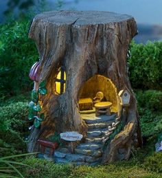 Main image for Miniature Fairy Garden Solar Staircase Stump House from Plow and Hearth but out of stock.but I'll keep checking! Expand your fairy garden with our delightful Miniature Fairy Garden Solar Staircase Stump House, solar-powered to light the w Garden Crafts, Garden Projects, Garden Art, Diy Projects, Succulent Planters, Diy Garden, Hanging Planters, Hanging Baskets, Succulents Garden