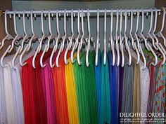 Store tissue paper on kids hangers - what a great idea! Could do this with fabric too
