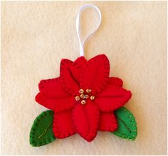 If you give handmade ornaments as Christmas gifts, it's time to start stitching! Deborah Schlegel of Art Threads is sharing patterns and tutorials for two sweet felt ornaments–a tree an… Felt Christmas Decorations, Christmas Ornaments To Make, Christmas Sewing, Christmas In July, Felt Ornaments, Christmas Projects, Felt Crafts, Handmade Christmas, Holiday Crafts