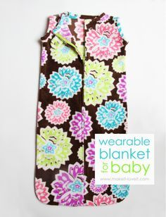 "Wearable baby blanket. Use instead of loose blankets to keep baby warm while sleeping. Easy 1 day project. 1 yard of fleece or flannel, 22"" zipper, 1 snap, & basic sewing supplies. Use a wide-necked well-fitting top as a pattern. Cut wider & curved at the bottom & add several inches to baby's length. Make 2: 1 for use, 1 for wash."