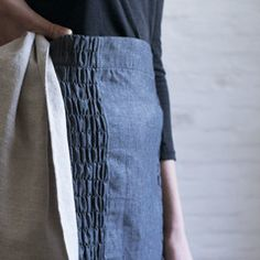 pilo.ca : linen half apron with elasticized side smocking. hemp ribbon tie. one size fits all.