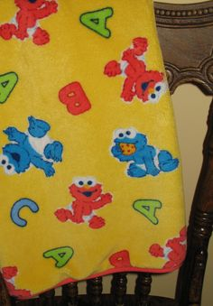 Adorable fleece baby blanket features Cookie Monster and Elmo when the were  babies!  elmo 787588352