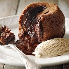 Nothing is quite as satisfying as the first bite of a Molten Chocolate Cake! This is a great recipe for your Valentine's Day plans too: http://www.bhg.com/recipes/desserts/cakes/chocolate-lava-cake-recipes/?socsrc=bhgpin012914moltenchocolatecakes&page=2