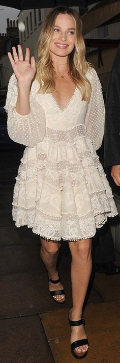 Who made Margot Robbie's white lace dress and black sandals?
