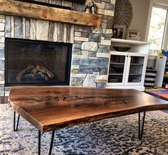 One of our great clients sent in this pic from their living room showing their new live edge black walnut coffee table on hairpin legs.  Looking good in the background is a reclaimed hand hewnbarn mantle we did for them also.  Come and see us in our Hamilton or Toronto shops for the best selection of live edge wood barn board and reclaimed wood!  liveedge #liveedgewalnut #blackwalnut #barnboard #barnwood #barn #reclaimed #reclaimedwood #rustic #rusticwood #igers #toronto #hamilton #hamont…