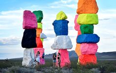 A perfect perch for a selfie with this large-scale public art installation titled Seven Magic Mountains by Swiss artist Ugo Rondinone. The artwork, comprised of seven towers of colorful, stacked boulders standing more than thirty feet high, was recently completed in the desert south of Las Vegas. / AFP / David Becker (Photo credit should read DAVID BECKER/AFP/Getty Images)