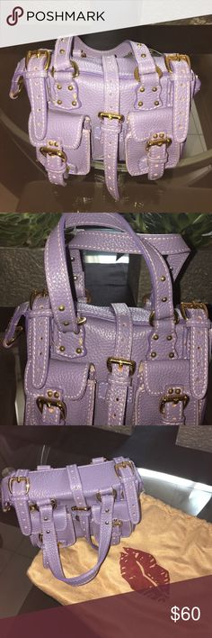 Two Lips Lavender Mini Tote Purse BNWT Two Lips Pepple Leather Lavender Mini Tote Purse and dustbag. Gold hardware and suede on the inside. Measures approx 6.5 in L and 4.5 in H. Thank you for looking. 😊 Two Lips Bags Mini Bags