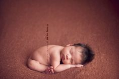 sleepy newborn pose