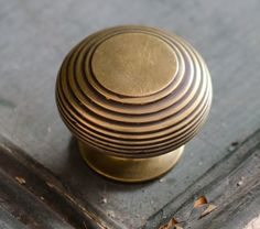Reproduction large aged brass cupboard knob.