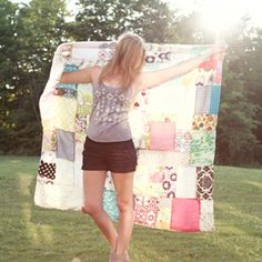 Have a spare afternoon? Click to see how to make a really quick patchwork/beach blanket using fabric scraps!