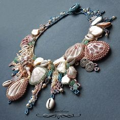 A wonderful freeform necklace featuring numerous sea shells individually embroidered .