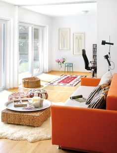 Nice bright living room with an orange couch.