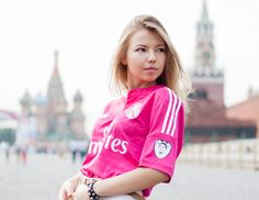 Moscow | Moskva - Russia. Real Madrid away shirt 2014/15 Golden Boy badge Pink and white Meet Liza showing the true Red colors directly on the Red Square in front of the Kremlin and St. Basil's cathedral.