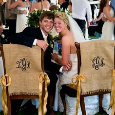 Burlap monogram chair covers for bride and groom at reception.