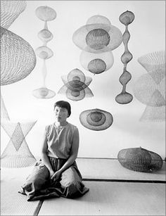 Ruth Asawa with several hanging sculptures Photo by Nat Farbman for TimeLife