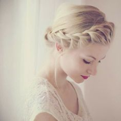 Pretty braided along the front of her crown int a small bun