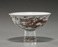 """Chinese 15th Century-style porcelain stem cup; with underglaze copper red writhing dragons among clouds design, cloud motif medallion to the center interior; D: 6"""""""