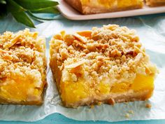 These rich and gooey Pineapple Crumble Bars just might replace your usual lemon squares. Flavored with brown sugar, ginger, vanilla, and fresh pineapple, these bar cookies will stand out at any bake sale or dessert spread. Our Test Kitchen recommends … Köstliche Desserts, Delicious Desserts, Yummy Food, Vanilla Desserts, Layered Desserts, Indian Desserts, Pineapple Desserts, Fresh Pineapple Recipes, Coconut Cookies