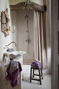 Love the glamour of the molding over the shower. Reminds me of what normally goes above a master bed in a formal room. Adds a nice touch to the bathroom:) Love this bathroom