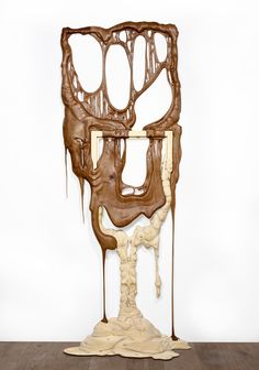 """Adrien COROLLER is an artist who likes to play with wood and its aspects to contradict the physical characteristics. He made 2011 a series of sculptures called Heartwood, the heartwood is the internal part of the wood, corresponding to the increase in the oldest areas formed, no longer contain living cells. Also called """"heart wood"""" or """"heartwood"""", it is a hard wood, compact, dense, dry rot. Gives impression that his wooden frames are melting as if they were made of chocolate."""