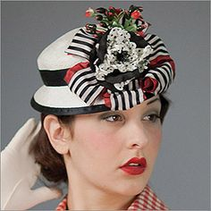• Doll Hat VII  • Design by Louise Green   • Fabric: Sisal Straw, Flower, Ribbon  • Colors: Natural with Black & Scarlet