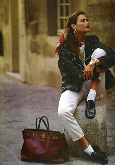 Carre Otis- scarf in hair, leather jacket, black loafers in the 90's.