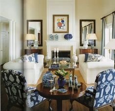 Like this look- two couches- two mirrors - the mantle setup- the use of blue... Chinoiserie in small living room