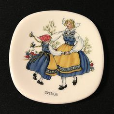 Small porcelain plate by Rörstrand Sweden with woman and child in folk costumes