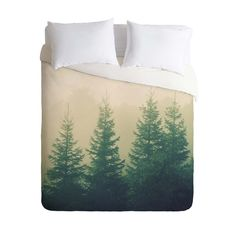 This gorgeously chic duvet cover will bring about compliments all year round. Cozy and bold, the evergreen pine print looks great paired with earthy tones and rustic wood. Dare to contrast with seasona...  Find the Winter Pines Duvet Cover, as seen in the Urban Cowboy:  Day Two  Collection at http://dotandbo.com/collections/48-hours-at-urban-cowboy-day-two-stay-in-the-cabin?utm_source=pinterest&utm_medium=organic&db_sku=94918