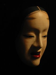 A Noh mask called Zo-onna.  The mask represents a young woman with a dignified and reserved demeanour. The zō-onna mask is used for roles requiring refined elegance.