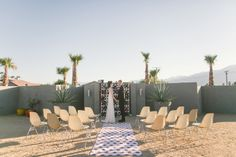MID-CENTURY MODERN PALM SPRINGS WEDDING INSPIRATION  |  Photography by Jessica Claire  | Hotel Lautner |  Floral design by Oak & the Owl  | Yeah! rentals - Eames chairs  | screen block wall; breeze blocks