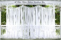 diy wedding fabric backdrop with lights   This backdrop is a mix of hand cut All White fabric strips of satin ...