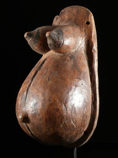 Female belly mask - Makonde - Tanzania  This type of mask is intended to celebrate the rituals related to fruitfulness.