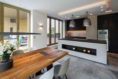 Küche mit Sichtbeton und Altholztisch - Crownhill-Interieur