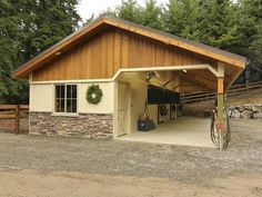 Open breezeway barn with board and batten gable ends, stone wainscot wrap and powder-coated stall fronts. This shedrow barn couldn't be any more perfect!   Horse Barns | Horse Stables | Shedrow | Barn Inspiration | Small Horse Barn Ideas  -ontfequestrian