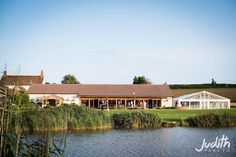 Enjoy #exclusive use of the #venue at #quantocklakes  #barn #lakeside #marquee #waterside #weddingvenue with a #view of the #quantockhills and #somerset #countryside by @judithparkynphoto at @quantocklakesuk