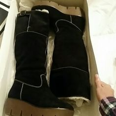 KORS Michael Kors boots Black boots with white stitching and kors on side buckles and gum bottoms...they are in very good shape KORS Michael Kors Shoes Winter & Rain Boots