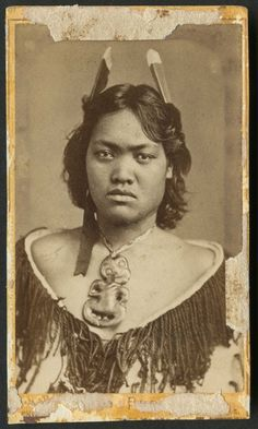 Portrait of a woman from the Aperahama family of Manaia, with a hei tiki, cloak, and feathers.