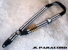 Tactical Single/Dual Point Adjustable Rifle Sling In Black/Desert Sand 550 Paracord Lumbar Stitch. Features a Matching DTOM Dont Tread On Me PVC