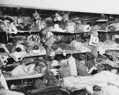 U.S. Navy men sleep as they journey to one of the fighting fronts, 29 June 1943