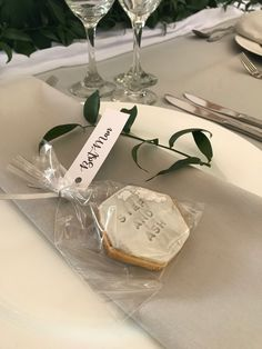 personalised hexagon cookie wedding favours with silver leaf and place name tag label. grey napkins and white charger plates. Wedding Favour Name Places, Name Place Cards Wedding, Wedding Name, Wedding Dreams, Wedding Cards, Wedding Stuff, Our Wedding, Dream Wedding, Wedding Favour Cookies