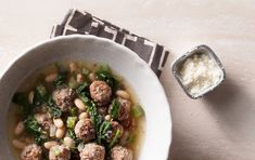 Hearty Meatball Soup with Spinach...I would substitute Ground Chicken in the place of the Beef, or perhaps a mixture of lean Beef, Pork, and Chicken..Yummy!