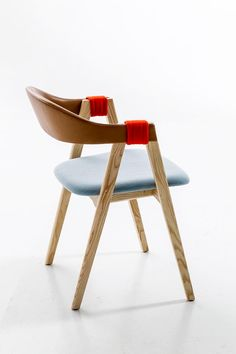 Patricia Urquiola's Mathilda chair for Moroso has a curved plywood backrest, which comes encased in woven rush or in fabric and is bound to the A-shaped wooden legs with a contrasting colour. This Hub product is proudly GECA certifi...