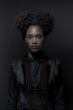 Efi Gloom. A former slave who escaped from the de la Vie family and rose to power in the Gloom business before winning over the patriarch at the time. She is heralded as a heroine, and her rise continued the rivalry between the Gloom and de la Vie family.