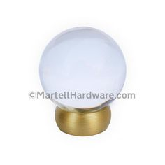This transparent clear glass cabinet knob with ball design is part of the Glass Ball Series from Lew's Hardware. This knob features a solid brass brushed brass finish stem. The transitional globe design can be used in a traditional or modern setting. The knobs are threaded and glued to the brass base and are rear post mounted.