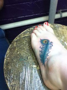 peeacock feather tattoo