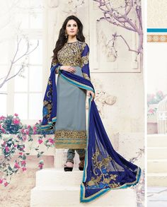 Grey and blue straight suit with golden embroidered yoke   1. Grey and blue poly georgette suit2. Comes with matching bottom and dupatta3. Can be stitched upto bust size 42 inches